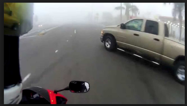 A car pulling into a motorcyclist's lane