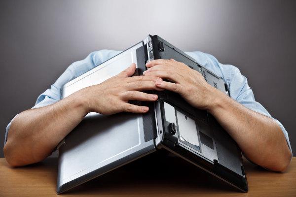 Hiding head under open laptop