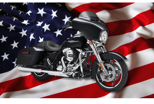 A Harley Davidson Motorcycle in front of a US flag